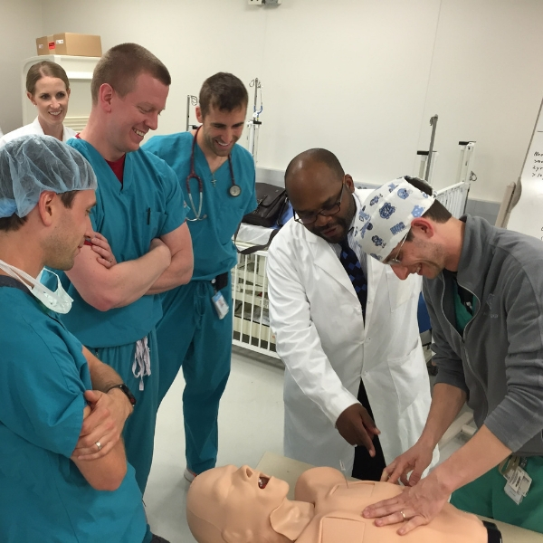 Anesthesiologists Practicing with Medical Dummy