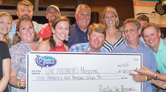 group holds donation check