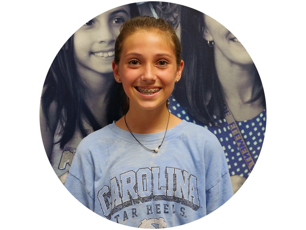 Girl smiling with UNC shirt