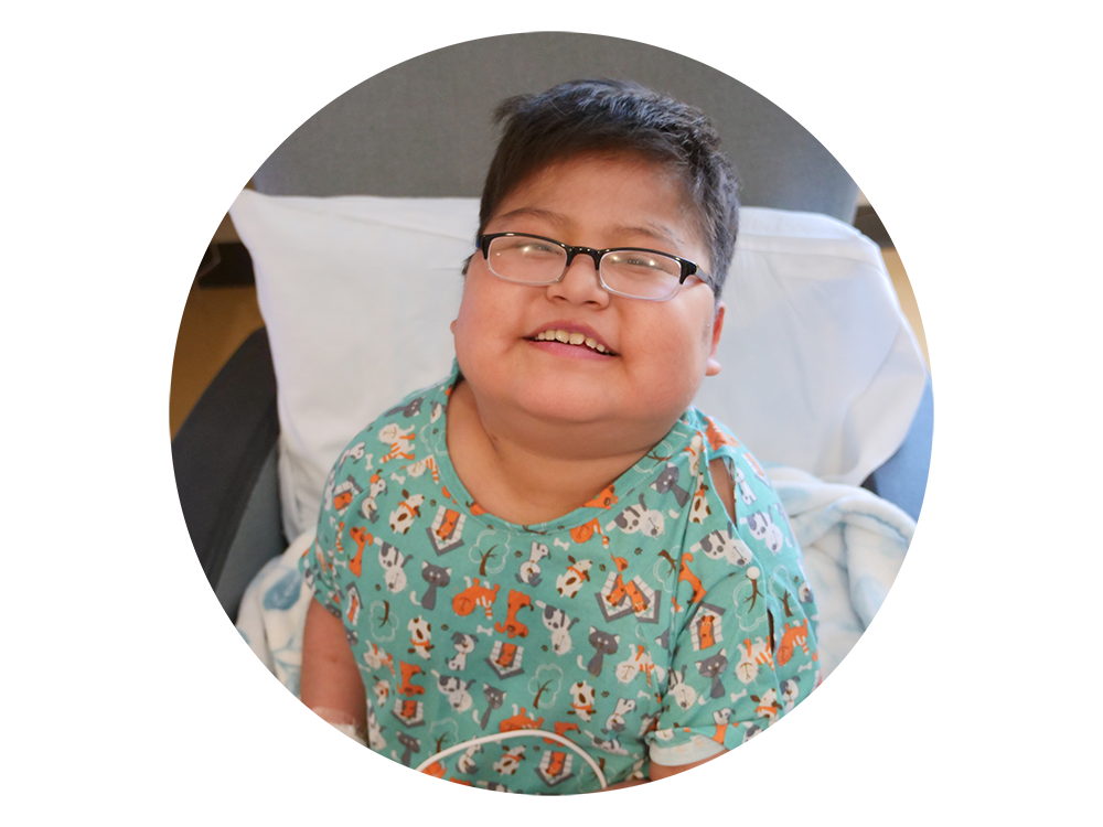 boy in hospital gown smiling