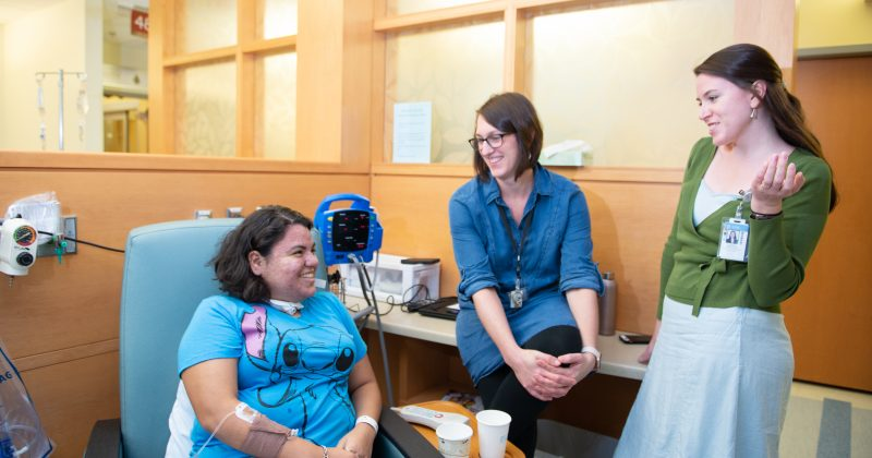Lauren Lux, MSW, and Catherine Swift, LCWSA, chat with a patient.