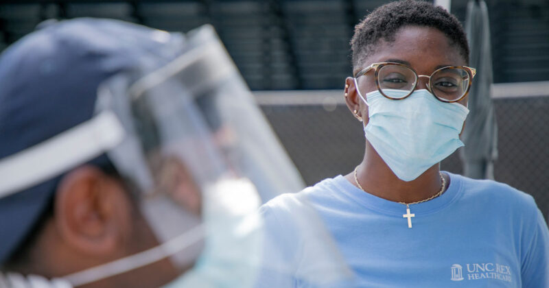 Population Health Services Manager Randi Towns leads a UNC Health Alliance team at a mobile health clinic providing COVID-19 testing and related services to the community on August 21, 2020 in Raleigh, NC on the campus of St. Augustine's University, a community partner in providing the valuable services.