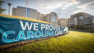"Banner at UNC Medical Center that says ""We Provide Carolina Care"""
