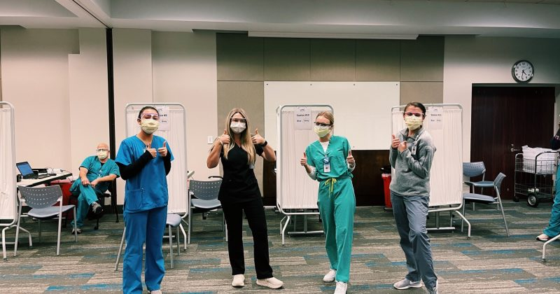 UNC School of Medicine students volunteer at the Friday Center vaccine clinic.