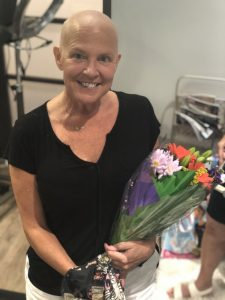 Patti Brenton holding flowers